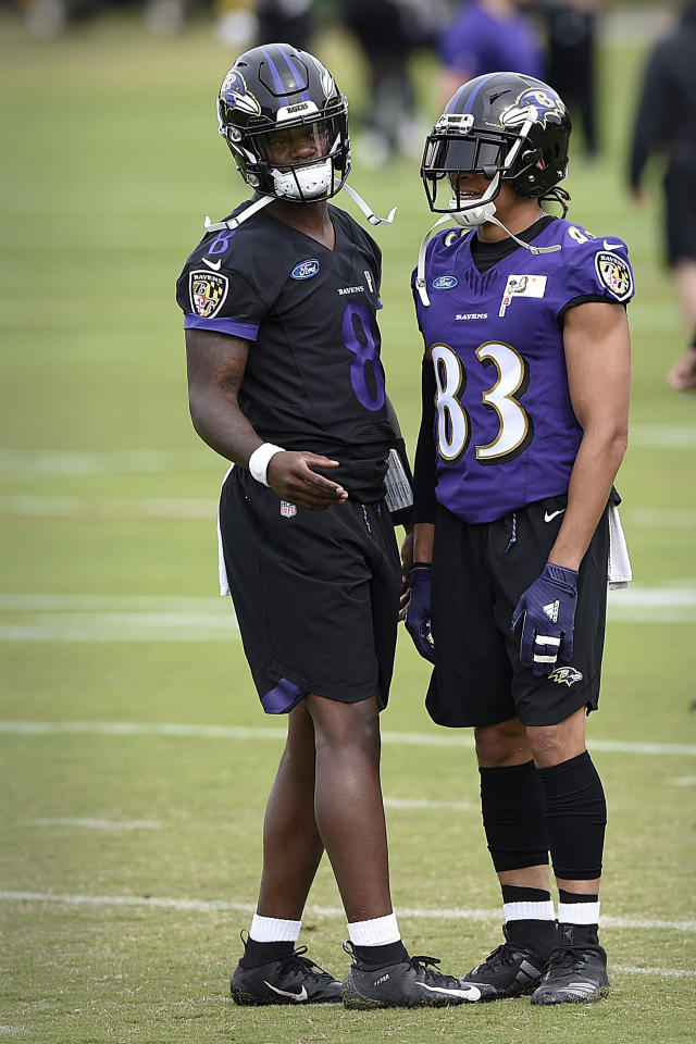 Baltimore Ravens quarterback Lamar Jackson, left, talks with wide receiver Willie Snead IV at the team's NFL football training facility in Owings Mills, Md., Wednesday, June 12, 2019 (AP Photo/Gail Burton)