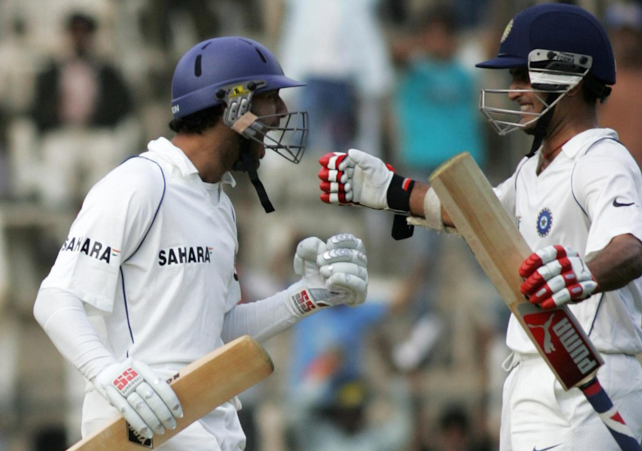 Indian cricketer Yuvraj Singh (L) celebrates scoring a century (100 runs) with teammate Sourav Ganguly during the first day of the third Test match between India and Pakistan at The Chinnaswamy Stadium in Bangalore, 08 December 2007. India have scored 289runs for the loss of four wickets after winning the toss and electing to bat.      AFP PHOTO/Dibyangshu SARKAR (Photo credit should read DIBYANGSHU SARKAR/AFP/Getty Images)
