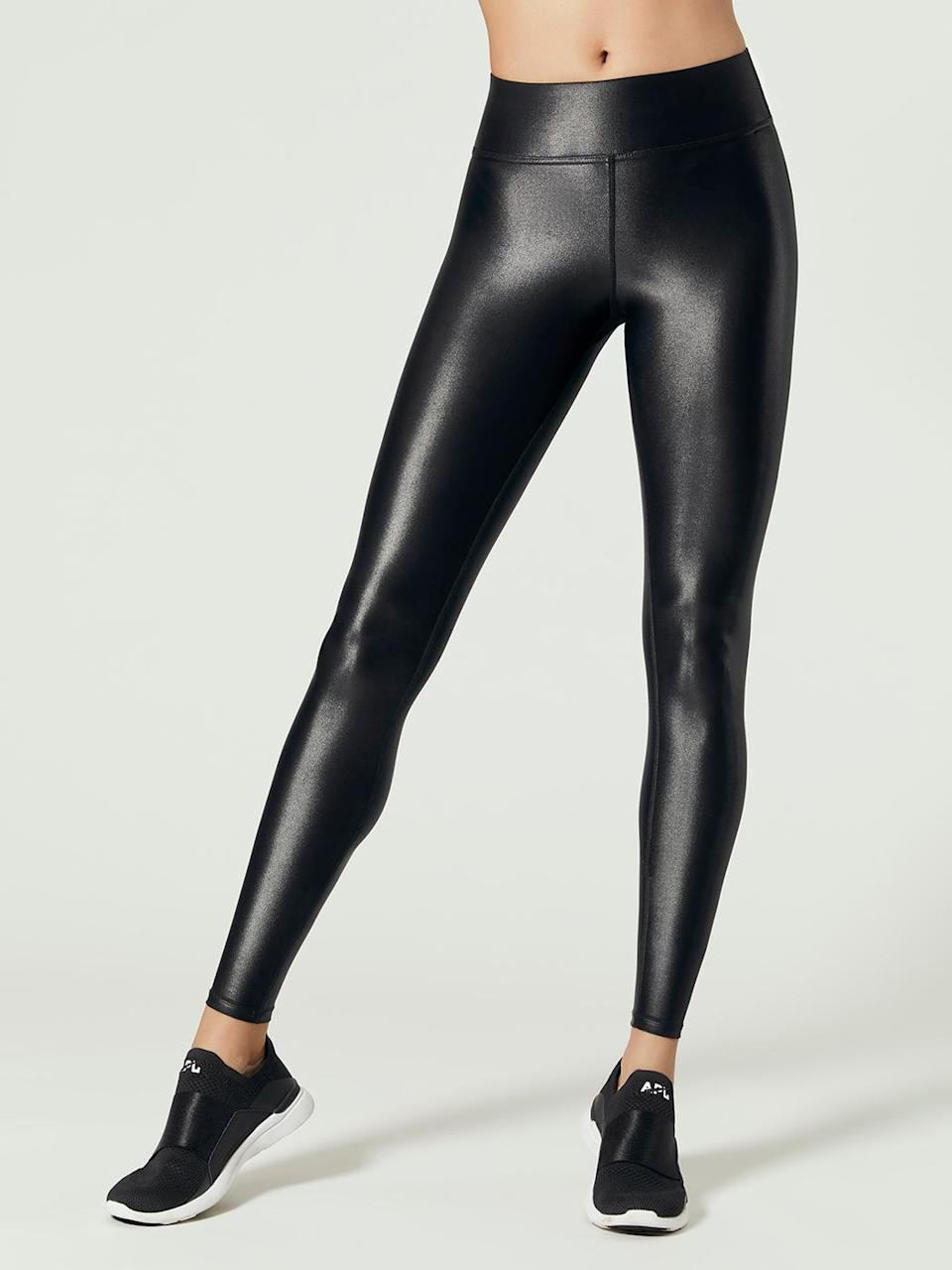 """<strong><h3>Carbon38: The Luxury Legging</h3></strong><br>Who said leggings couldn't be luxurious? The Takara legging comes in a glossy liquid finish for that perfect model-off-duty look.<br><br><strong>The hype:</strong> 4.6 out of 5 stars and 475 reviews on Carbon38<br><br><strong>What they're saying:</strong> """"These leggings are amazing! I am so happy I finally found a style/size that fit amazing (I'm 5'6, 125lb, and the XS fits perfectly). I tried the High-Waist Takara Leggings in two different sizes and the waistband on that style is way too uncomfortable and high, regardless of size. The regular Takara Leggings have a fairly high waistband with a super flattering and comfortable fit anyway, which makes these are the perfect leggings for working out and wearing around town!"""" - Jackie, Carbon38 Review<br><br><strong>Carbon38</strong> Regular Rise Full-Length Takara Shine Legging, $, available at <a href=""""https://go.skimresources.com/?id=30283X879131&url=https%3A%2F%2Fwww.carbon38.com%2Fproduct%2Ftakara-leggings"""" rel=""""nofollow noopener"""" target=""""_blank"""" data-ylk=""""slk:Carbon38"""" class=""""link rapid-noclick-resp"""">Carbon38</a>"""