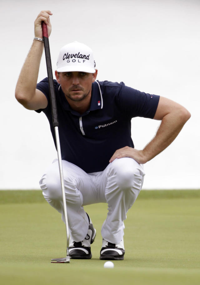 Keegan Bradley measures his shot on the fourth green during the first round of the Houston Open golf tournament on Thursday, April 3, 2014, in Humble Texas. (AP Photo/Patric Schneider)