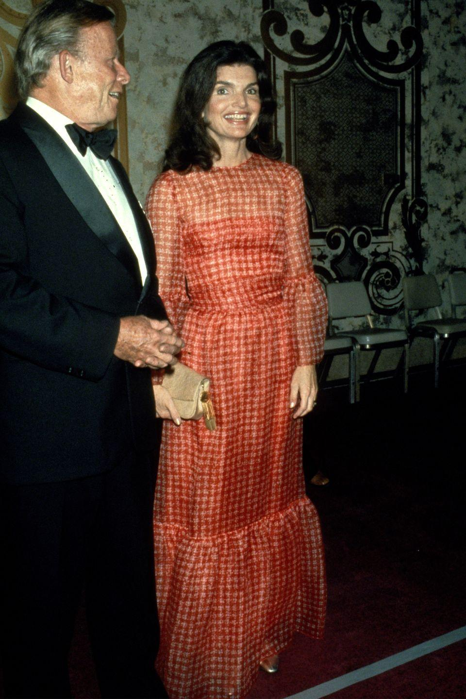<p>Jackie sported another silk gown during a visit in Washington, DC, this one fashioned in a bright checkered print. </p>