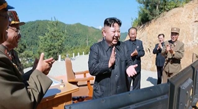 A news bulletin shows North Korea leader Kim Jung Un applauding after the launch of a Hwasong-14 intercontinental ballistic missile. Source: AAP