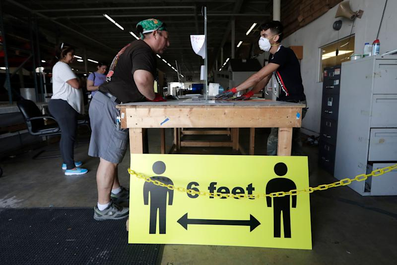 A sign advises social distancing of 6 feet to protect against the coronavirus in Hialeah, Florida. (Photo: ASSOCIATED PRESS)