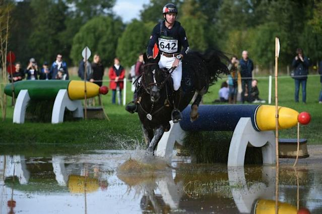 A horse and his rider during the Cross Country event at the Mondial du Lion-d'Angers world championships Le Lion d'Angers, France (AFP Photo/JEAN-FRANCOIS MONIER)