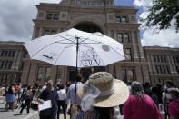 Supporters of voting rights gather for a rally on the steps of the Texas Capitol, Thursday, July 8, 2021, in Austin, Texas. Texas Gov. Greg Abbott called a special session that began Thursday. (AP Photo/Eric Gay)