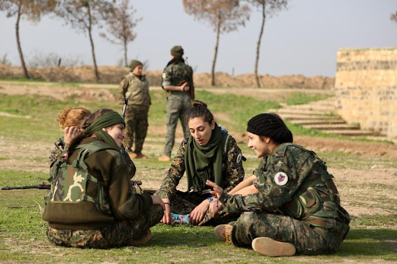 """The """"Female Protection Forces of the Land Between the Two Rivers'"""" first major action was alongside the Syrian Democratic Forces, a coalition of Kurdish, Arab and Christian fighters, which recently recaptured the strategic town of Al-Hol (AFP Photo/Delil Souleiman)"""