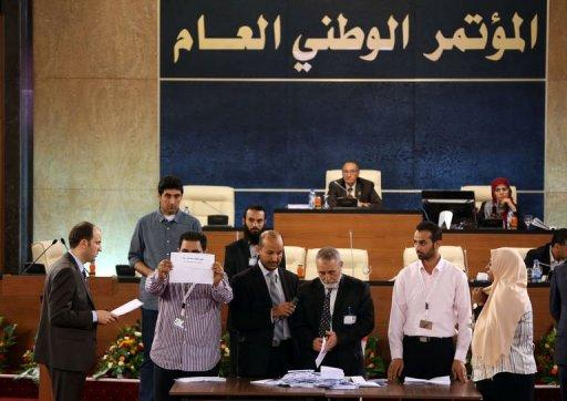 Members of the National assembly sort ballots as they choose their president in Tripoli on August 9, 2012. The new GNC president, Mohamed al-Megaryef, an economist with a British doctorate in finance, had held leading posts under the Kadhafi regime in the 1970s