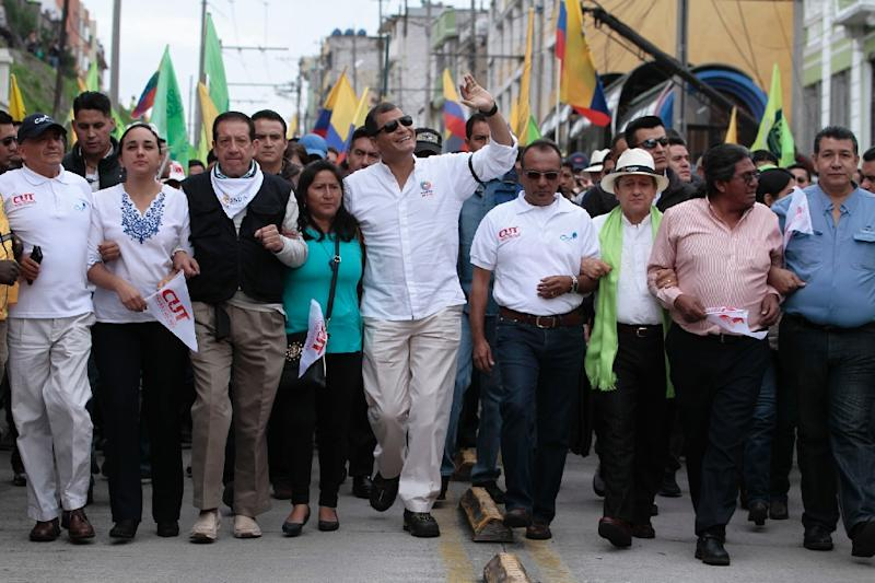 Ecuadorean President Rafael Correa (C) participates in a May Day march on May 1, 2015 in Quito (AFP Photo/Juan Cevallos)