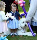 <p>During the same party, she made friends with a dog called Moose.<br><i>[Photo: PA]</i> </p>