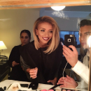 Guiliana Rancic, who changed her look after the pre-show, huddled with her beauty crew to take a mirror selfie of her lip color du jour – berry. @guilianarancic/Instagram