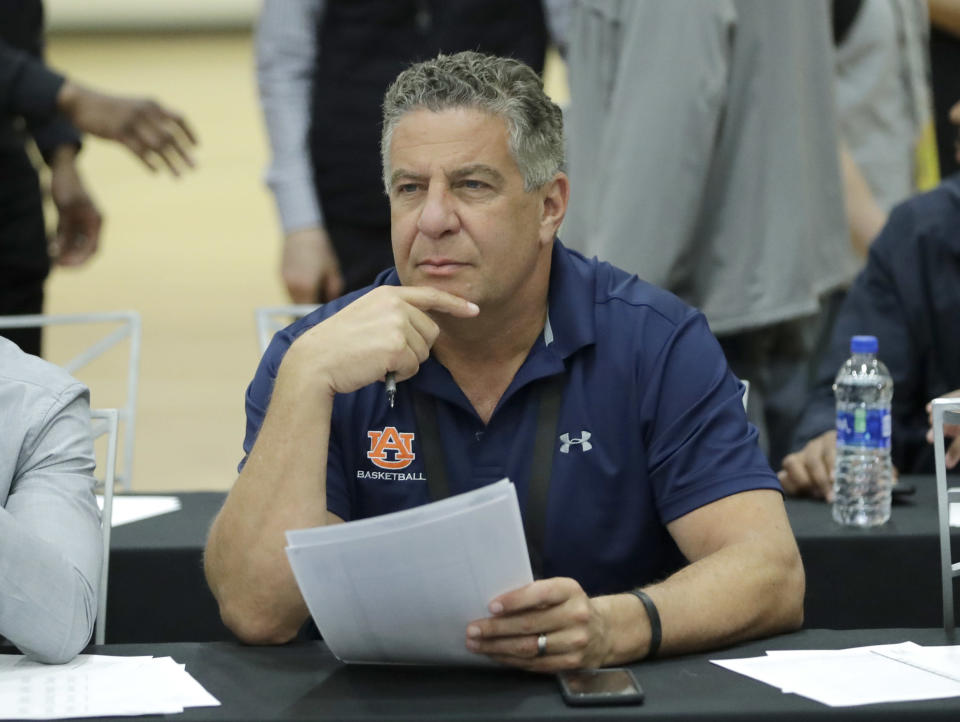 FILE – In this May 17, 2018, file photo, Auburn head coach Bruce Pearl attends the NBA draft basketball combine in Chicago. Auburn has given basketball coach Bruce Pearl a five-year contract extension. Pearl led the Tigers to a share of their first Southeastern Conference regular season title since 1999 last season despite having two top players ineligible. The extension announced Monday, June 4, 2018, runs through the 2022-2023 season. (AP Photo/Charles Rex Arbogast, File)