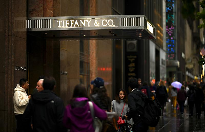 People walk past the headquarters of luxury jewelry and specialty retailer Tiffany & Co on 5th Avenue in Manhattan on October 27, 2019 in New York City. - LVMH, the French owner of Louis Vuitton, is exploring a takeover of Tiffany & Co to expand in the US jewelry market, according to reports. (Photo by Johannes EISELE / AFP) (Photo by JOHANNES EISELE/AFP via Getty Images)