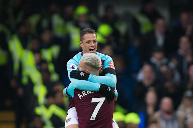 "West Ham United's Javier ""Chicharito"" Hernandez celebrates his goal at Chelsea with teammate Marko Arnautovic. (Getty)"