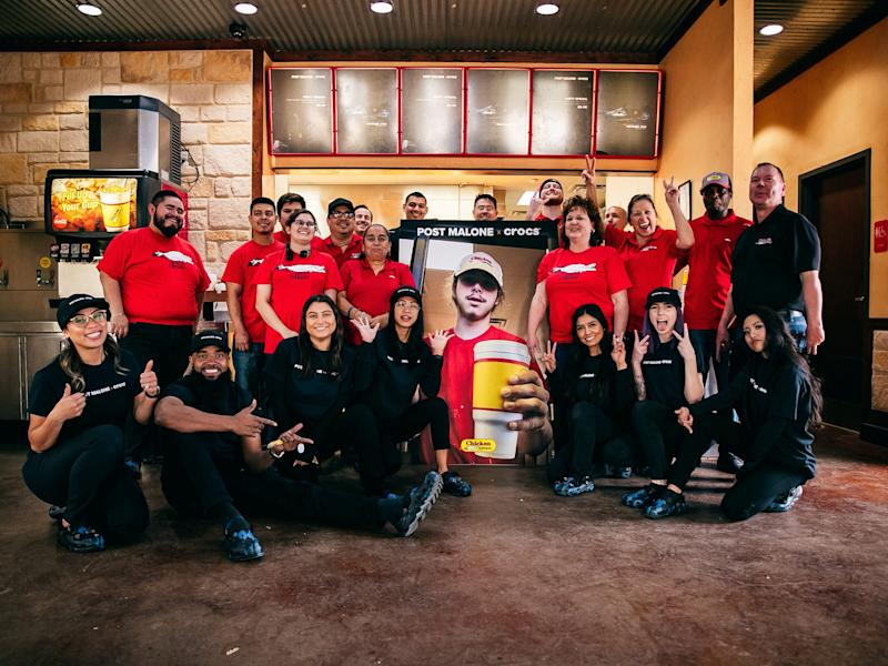 Chicken Express employees with a picture of young Post Malone.