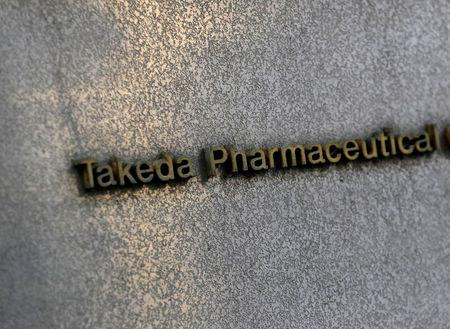 FILE PHOTO: Takeda Pharmaceutical's signboard is seen on its headquarters building in Tokyo, Japan January 30, 2018.  REUTERS/Kim Kyung-Hoon/File Photo