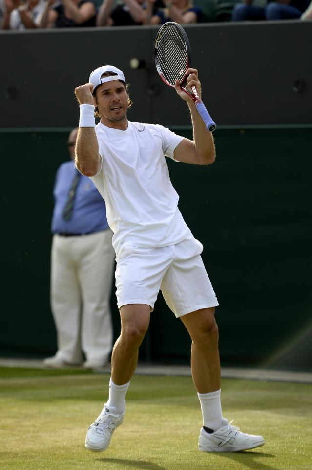 LONDON, ENGLAND - JUNE 29: Tommy Haas of Germany celebrates match point during the Gentlemen's Singles third round match against Feliciano Lopez of Spain on day six of the Wimbledon Lawn Tennis Championships at the All England Lawn Tennis and Croquet Club on June 29, 2013 in London, England. (Photo by Dennis Grombkowski/Getty Images)
