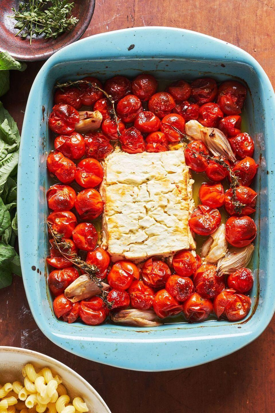 """<p>Obviously roasting a block of feta with bursting tomatoes is going to be amazing. But is it good enough to break the internet? Our answer, begrudgingly, is yes. It's genius! </p><p>Get the <a href=""""https://www.delish.com/uk/cooking/recipes/a35426947/baked-feta-pasta-tiktok/"""" rel=""""nofollow noopener"""" target=""""_blank"""" data-ylk=""""slk:Baked Feta Pasta"""" class=""""link rapid-noclick-resp"""">Baked Feta Pasta</a> recipe.</p>"""