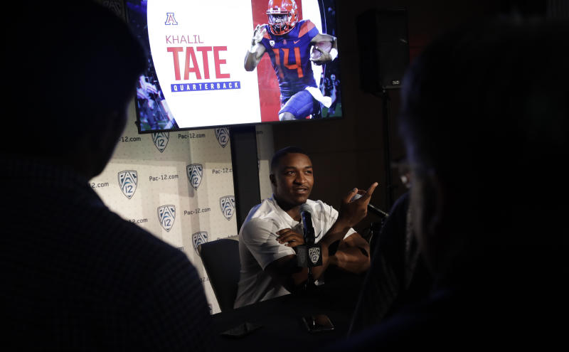 Arizona quarterback Khalil Tate answers questions during the Pac-12 Conference NCAA college football Media Day Wednesday, July 24, 2019, in Los Angeles. (AP Photo/Marcio Jose Sanchez)