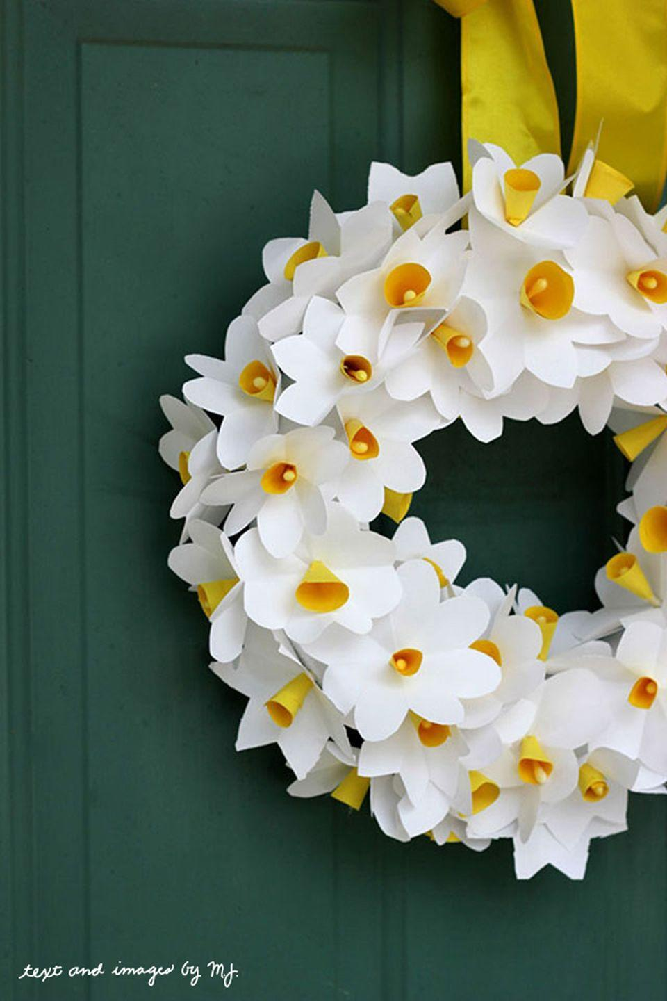 """<p>Welcome Mom home with a <a href=""""https://www.countryliving.com/diy-crafts/g4395/summer-wreaths/"""" rel=""""nofollow noopener"""" target=""""_blank"""" data-ylk=""""slk:homemade wreath"""" class=""""link rapid-noclick-resp"""">homemade wreath</a> on her front door. She can leave it up all summer long.</p><p><strong>Get the tutorial at <a href=""""http://www.classic-play.com/family-ties-make-paper-daffodils-with-your-kids/"""" rel=""""nofollow noopener"""" target=""""_blank"""" data-ylk=""""slk:Classic Play"""" class=""""link rapid-noclick-resp"""">Classic Play</a>.</strong></p><p><strong>What you'll need: </strong><em>yellow construction paper ($4 for pack of 50, <a href=""""https://www.amazon.com/SunWorks-Construction-12-Inches-18-Inches-50-Count/dp/B001E6CQGK"""" rel=""""nofollow noopener"""" target=""""_blank"""" data-ylk=""""slk:amazon.com"""" class=""""link rapid-noclick-resp"""">amazon.com</a>)</em></p>"""
