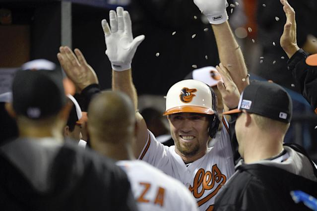 Baltimore Orioles' J.J. Hardy (2) is congratulated in the dugout after his solo home run in the seventh inning against the Detroit Tigers during Game 1 of baseball's AL Division Series, Thursday, Oct. 2, 2014, in Baltimore. (AP Photo/Nick Wass)