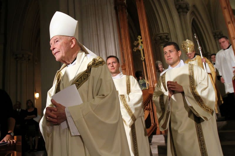 FILE PHOTO: Cardinal Theodore E. McCarrick, retired archbishop of Washington, processes at the beginning of a Mass at the Cathedral Basilica of the Sacred Heart in Newark