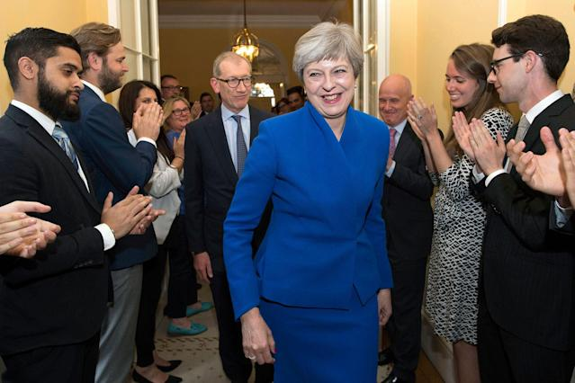 <p>Britain's Prime Minister Theresa May and her husband Philip are applauded by staff as they return to 10 Downing Street, after seeking permission from Queen Elizabeth to form a new government, in London, Friday, June 9, 2017. (Photo: Stefan Rousseau/Pool Photo via AP) </p>