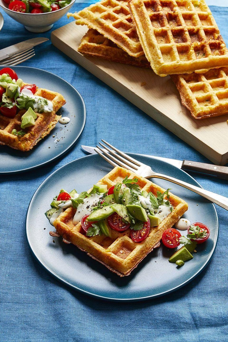 """<p>The sweetness from the waffles, the savory from the herb sald — it's all just too good. </p><p><strong><em><a href=""""https://www.womansday.com/food-recipes/food-drinks/a16759286/savory-corn-waffles-with-tomato-herb-salad-recipe/"""" rel=""""nofollow noopener"""" target=""""_blank"""" data-ylk=""""slk:Get the Savory Corn Waffles with Tomato Herb Salad recipe."""" class=""""link rapid-noclick-resp"""">Get the Savory Corn Waffles with Tomato Herb Salad recipe. </a> </em></strong></p>"""