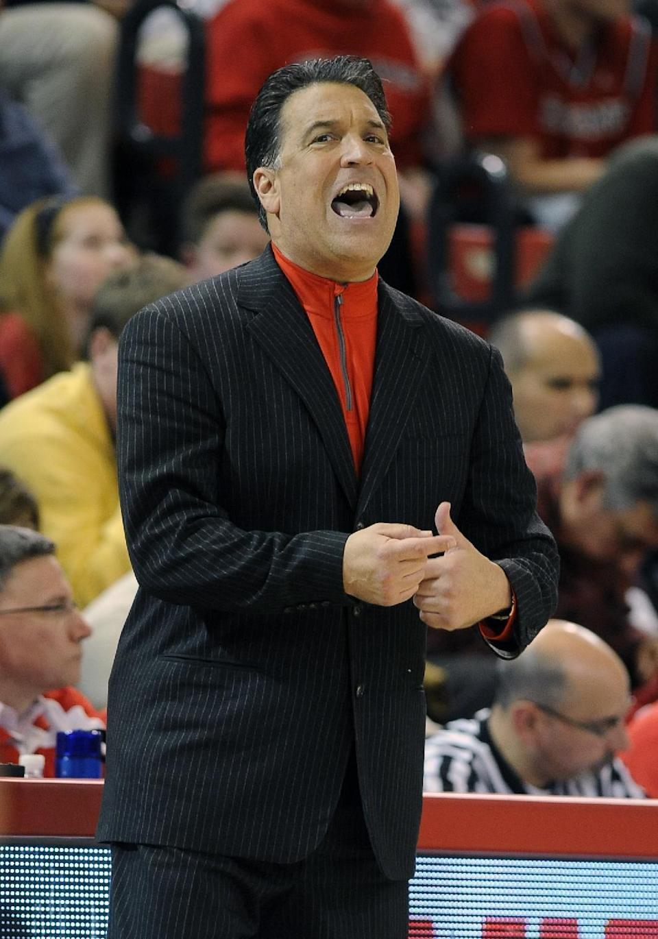 St. John's head coach Steve Lavin reacts to his team during the second half of an NCAA college basketball game against Long Beach State on Monday, Dec. 22, 2014 in New York. St. John's won 66-49. (AP Photo/Kathy Kmonicek)