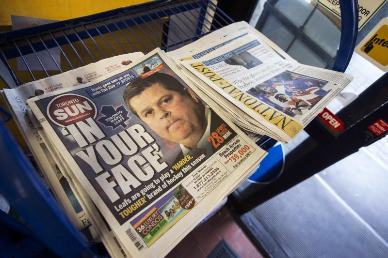 Toronto Sun and National Post newspapers are seen on a news stand in Toronto