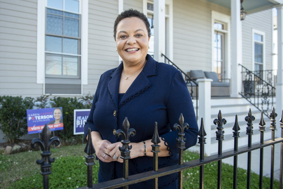 FILE - In this Wednesday, March 3, 2021, file photo, State Sen. Karen Carter Peterson poses outsider her home in New Orleans. Peterson is running for Louisiana's 2nd Congressional District seat which was vacated by Cedric Richmond after he left to be part of President Joe Biden's administration. (Chris Granger/The Times-Picayune/The New Orleans Advocate via AP, File)