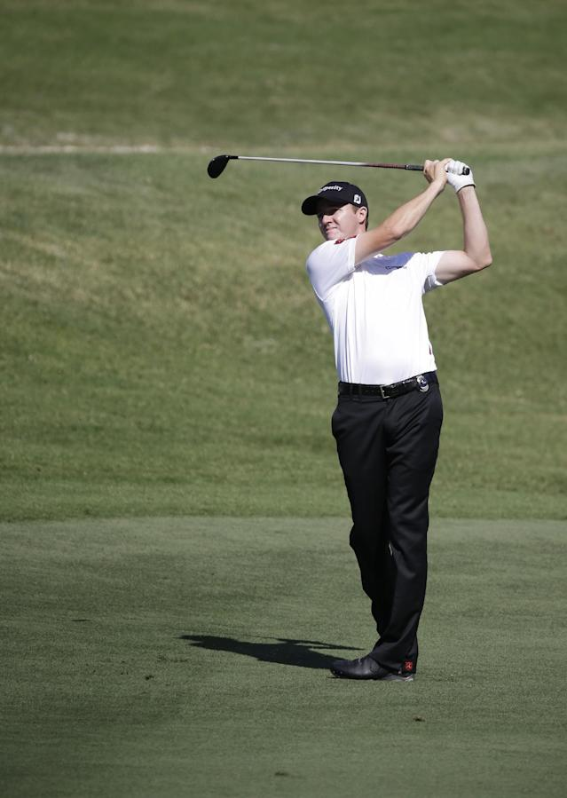 Jimmy Walker watches his shot from the 16th fairway during a practice round for The Players championship golf tournament at TPC Sawgrass in Ponte Vedra Beach, Fla., Wednesday, May 7, 2014. (AP Photo/John Raoux)