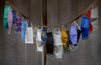 Various face masks are displayed in a shop window in Bad Vilbel near Frankfurt, Germany, Thursday, Sept. 24, 2020. (AP Photo/Michael Probst)