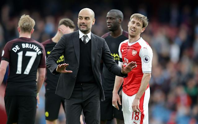 <span>Pep Guardiola has words with Monreal at full time</span> <span>Credit: Rex Features </span>