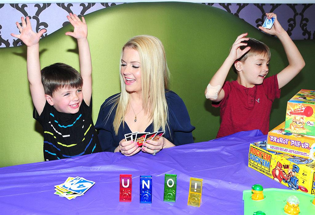 Uno! Mom of three Melissa Joan Hart took two-thirds of her brood -- sons Brady, 5, and Mason, 7 -- to her candy store SweetHarts in Sherman Oaks, California, over the weekend to celebrate Mattel's Great American Game Break. Don't you wish your mom owned a candy store? (4/28/2013)