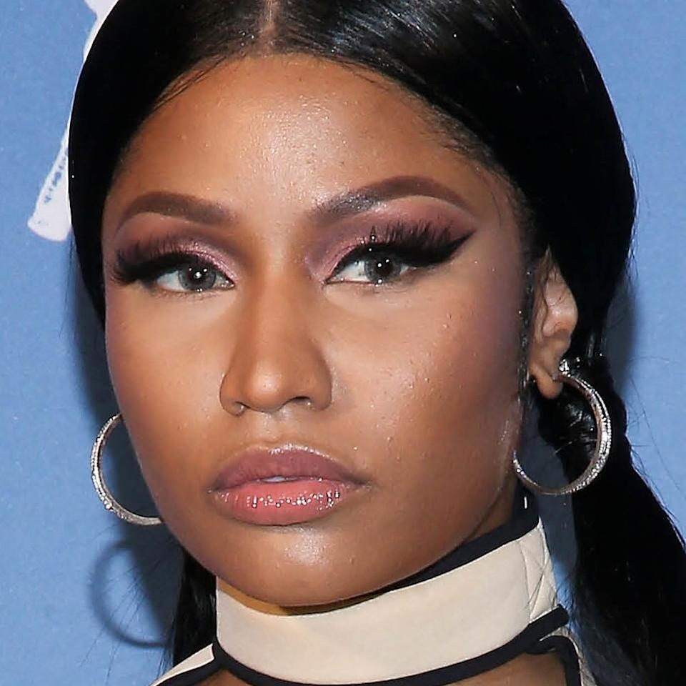 """<a rel=""""nofollow"""" href=""""https://www.allure.com/topic/nicki-minaj?mbid=synd_yahoo_rss"""">Nicki Minaj</a> might have used a filter to add a flower to her hair in a <a rel=""""nofollow"""" href=""""https://www.instagram.com/p/Bm88ZxlhQs4/?hl=en&taken-by=nickiminaj"""">recent Instagram selfie video</a>, but the hair itself is no filter. She switched to a half-up style of pastel pink, lilac, seafoam green, and sky blue, and her stylist, Tae, can be seen using a curling wand to give her gorgeous loose waves."""