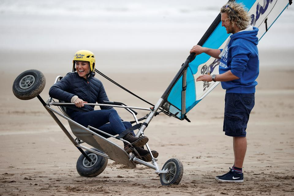 The Duchess of Cambridge land yachting with a group of young carers on the beach at St Andrews. Picture date: Wednesday May 26, 2021.