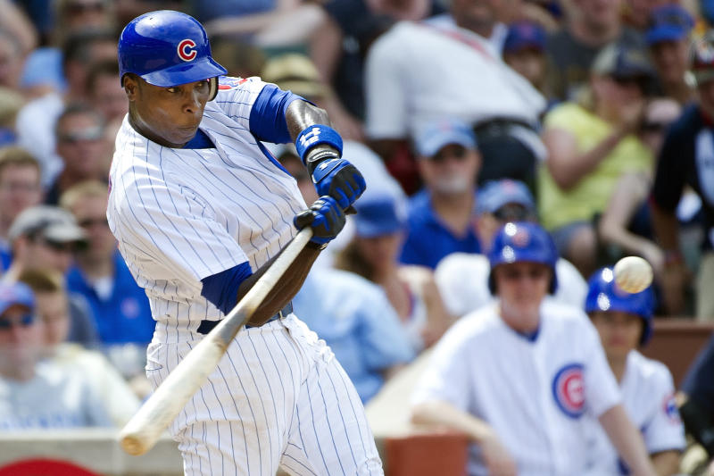 Chicago Cubs' Alfonso Soriano hits a two-run home run scoring Bryan LaHair during the sixth inning of a baseball game against the San Diego Padres, Monday, May 28, 2012, in Chicago. (AP Photo/Brian Kersey)