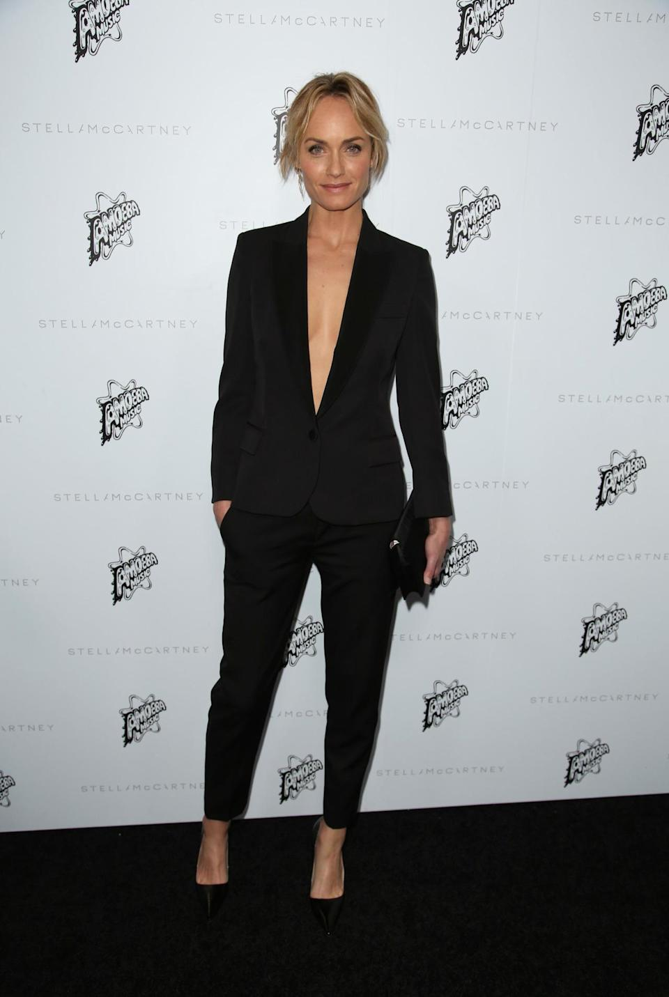 <p>Actress Amber Valletta showed off her slim frame in a trouser suit complete with plunging neck. <i>[Photo: Rex]</i></p>