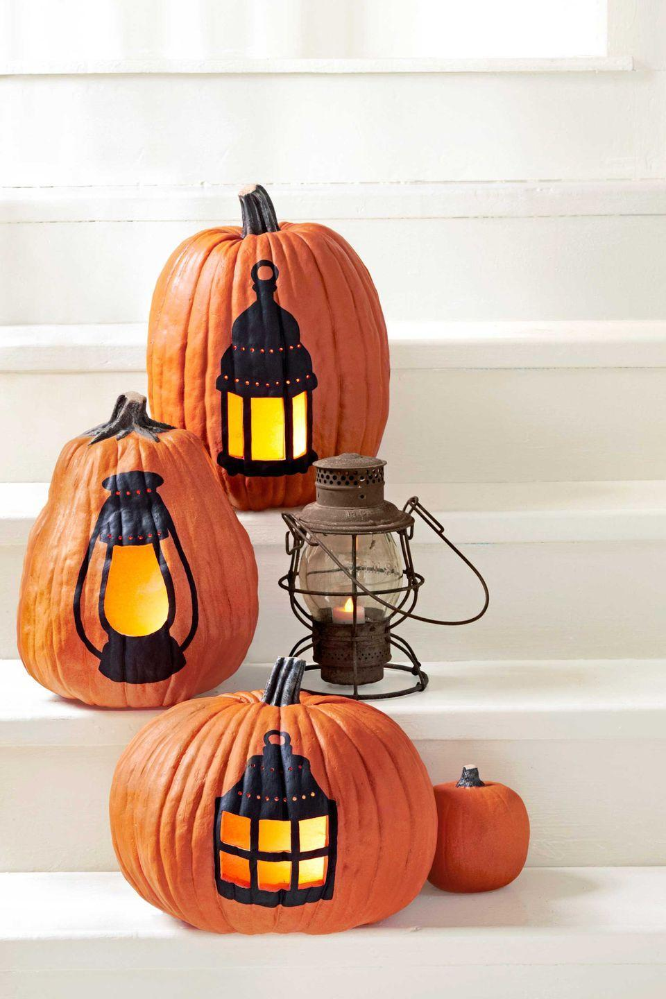 "<p>Put a cheeky spin on the word jack-o'-lantern with three glowing silhouettes of old-school lamps.</p><p><strong><a href=""https://www.countryliving.com/diy-crafts/how-to/a3031/lantern-pumpkin-1009/"" rel=""nofollow noopener"" target=""_blank"" data-ylk=""slk:Get the tutorial"" class=""link rapid-noclick-resp"">Get the tutorial</a></strong>.</p>"