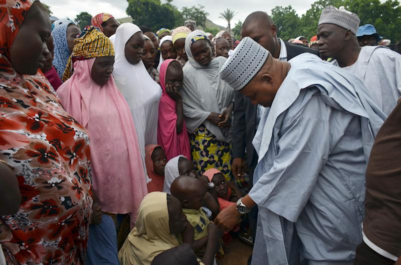 Borno State Governor Kashim Shettima (2nd right) visits internally displaced people at Madagali camp in Nigeria's northeastern Adamawa State on August 21, 2014 (AFP Photo/Olatunji Omirin)