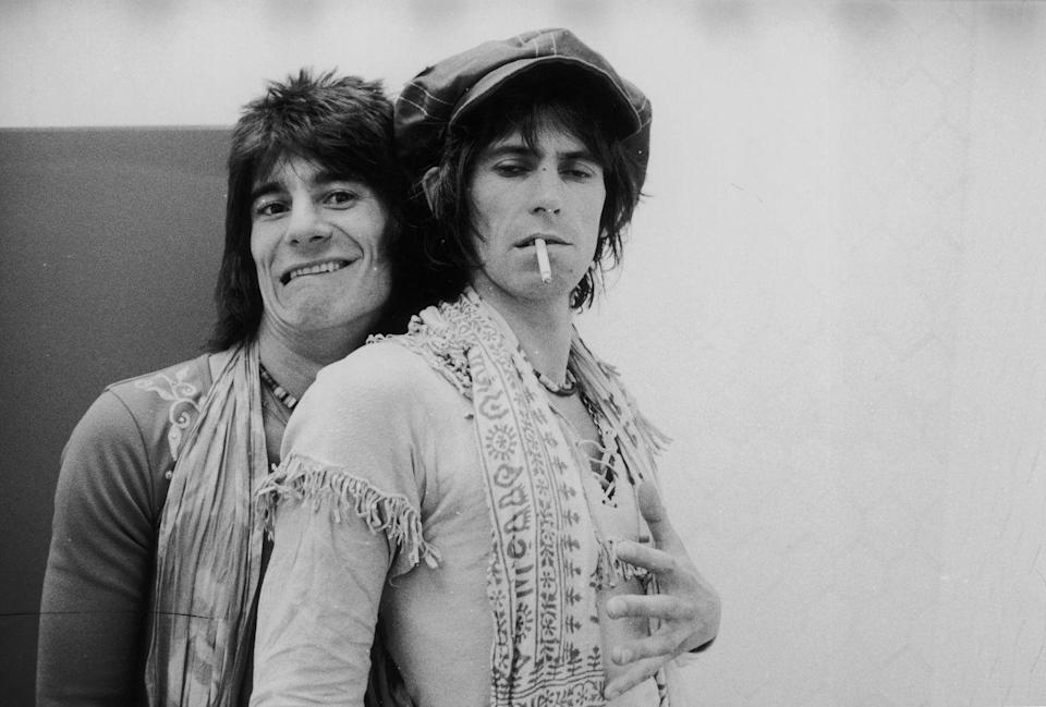 <p>Ron Wood embraces Keith Richards backstage during the Rolling Stones' 1975 Tour of the Americas.</p>