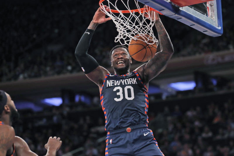 New York Knicks' Julius Randle dunks the ball during the second half of the NBA basketball game against the Miami Heat, Sunday, Jan. 12, 2020, in New York. The Knicks defeated the Heat 124-121. (AP Photo/Seth Wenig)