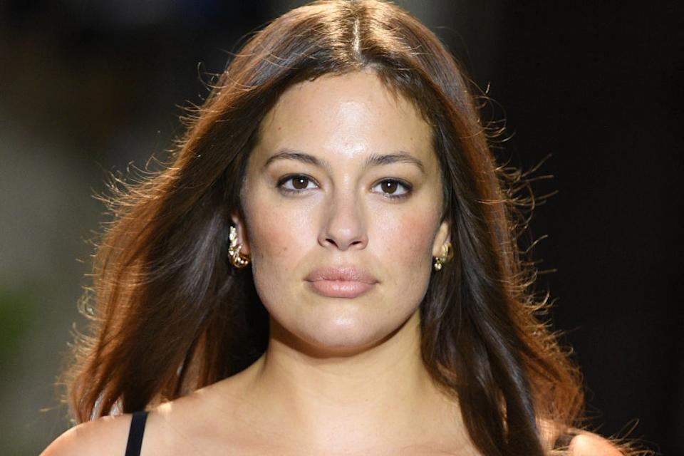 Ashley Graham has been praised for sharing an image showing off her natural armpit hair, pictured at Milan Fashion Week in September. (Getty Images)