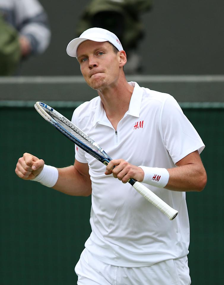 Czech Republic's Tomas Berdych celebrates defeating Slovakia's Martin Klizan during day Two of the Wimbledon Championships at The All England Lawn Tennis and Croquet Club, Wimbledon.