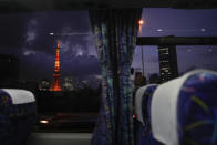 The Tokyo Tower is seen through a bus window ahead of the delayed 2020 Summer Olympics on Thursday, July 15, 2021, in Tokyo. (AP Photo/Jae C. Hong)