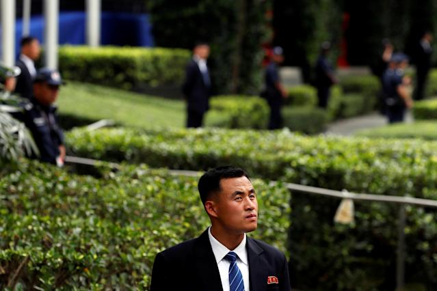<p>A member of the North Korean security personnel waits for the arrival of North Korea's leader Kim Jong Un outside St Regis hotel, ahead of the summit between the North Korean leader and President Donald Trump, in Singapore, June 10, 2018. (Photo: Tyrone Siu/Reuters) </p>