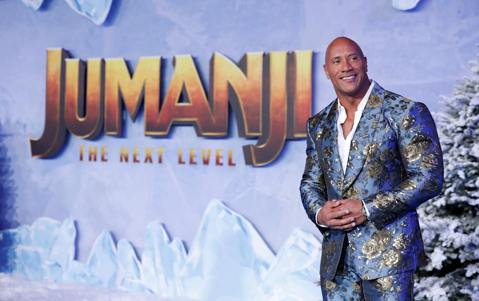 Cast member Dwayne Johnson poses at the premiere for the film
