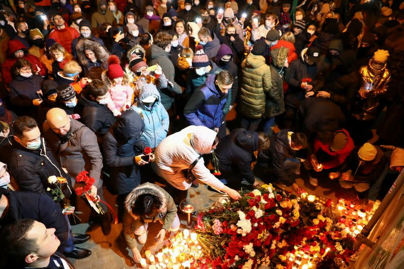 FILE PHOTO: People gather to mourn the death of anti-government protester Roman Bondarenko in Minsk