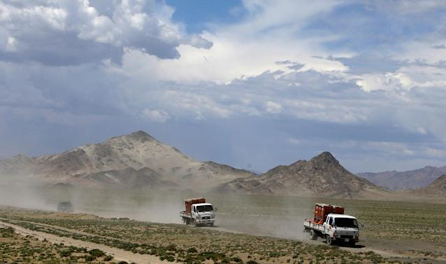 <p>Trucks carrying Przewalski's horses drive to Takhin Tal National Park, part of the Great Gobi B Strictly Protected Area, in south-west Mongolia, June 20, 2017. (Photo: David W. Cerny/Reuters) </p>