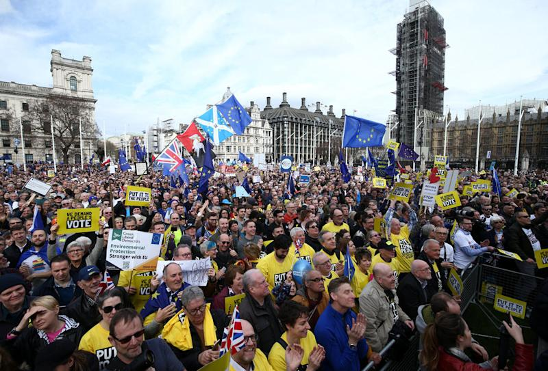 Protestors crowd Westminster's Parliament Square on Saturday.